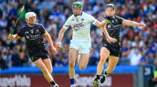 Tipperary's Ger Browne is closed down by Dan McCormack with Paddy Purcell of Laois. Photograph: Gary Carr/Inpho