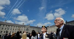 Herve Olivieri and Jaques Mention, veterans of the Algerian and Tunisian war, watch as the Aer Corps performs a flyover. Photograph: Alan Betson
