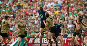 Mayo's Aidan O'Shea and David Moran of Kerry ascend under the dropping ball. Photograph: James Crombie/Inpho