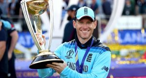 England's Eoin Morgan celebrates their win with the trophy during the ICC World Cup Final at Lord's, London. Photograph: Nick Potts/PA Wire.