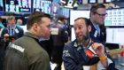Traders work on the floor of the New York Stock Exchange. Photograph: Lucas Jackson/reuters