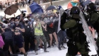 Protesters and riot police clash in Hong Kong shopping mall