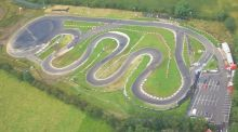 This aeriel shot shows the track snaking through the grounds with a large parking area adjacent.