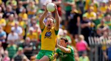 Meath's Padraic Harnan and Michael Murphy of Donegal in action. Photograph: Oisin Keniry/Inpho
