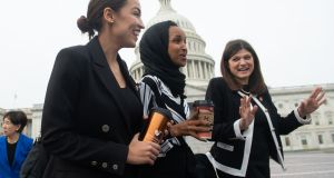 Democratic congresswomen  Alexandria Ocasio-Cortez and  Ilhan Omar with Republican House member Haley Stevens in Washington on January 4th last.   Photograph: Saul Loeb/AFP/Getty Images