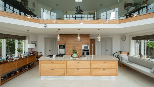 The kitchen, a vast double height space, spans the width of the property