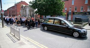 Family and friends following the hearse in the Liberties on their way to the funeral Mass of comedian Brendan Grace. Photograph: Nick Bradshaw/The Irish Times