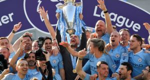 Manchester City manager Pep Guardiola lifts the trophy as they celebrate winning the Premier League in May. Photograph: Toby Melville/Reuters