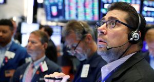 Traders  on the floor of the New York Stock Exchange on Friday. Wall Street's three main indexes flitted between slight gains and losses on Monday. Photograph: Lucas Jackson/Reuters