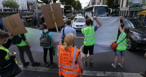 ROAD RAGE: Activists from the Extinction Rebellion environmental action group block traffic on Bachelor's Walk to highlight concerns about climate change. Photograph: Crispin Rodwell