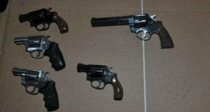 The arsenal included handguns laid out on a piece of cardboard, primed, armed and ready to be used, gardaí said.