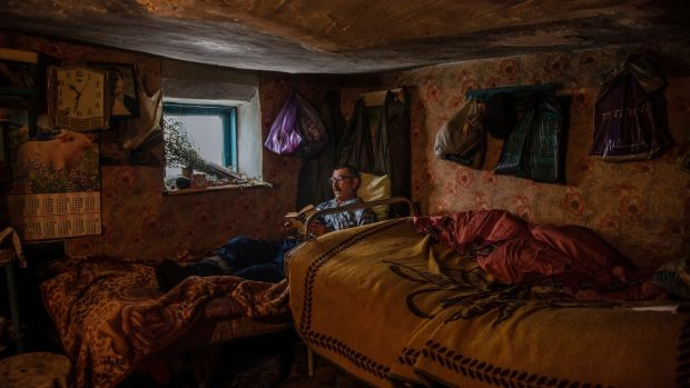 Grisa Muntean, who lives alone in the village of Dobrusa, Moldova, following the murder of its last two residents. 'The loneliness kills you.' Photograph: Laetitia Vancon/The New York Times