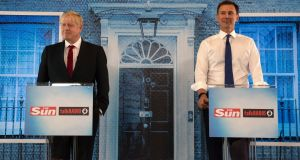 Conservative party leadership candidates Boris Johnson and Jeremy Hunt during a head-to-head debate hosted by The Sun at Talk Radio in The News Building, London. Photograph: Louis Wood/The Sun/PA Wire