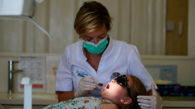 Dentist Gillian Smith with patient Millie Byrne. Photograph: Nick Bradshaw