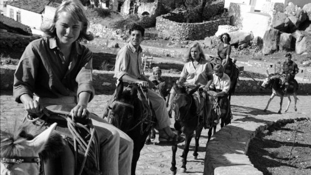 Marianne Ihlen, Leonard Cohen and others ride mules on the Greek island of Hydra in 1960. Photograph: James Burke/The Life Picture Collection/Getty Images