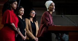 Democratic members of Congress Ayanna Pressley, Alexandria Ocasio-Cortez and Rashida Tlaib  listen as Ilhan Omar  speaks at a news conference on Capitol Hill in Washington on Monday. Photograph: Anna Moneymaker/New York Times