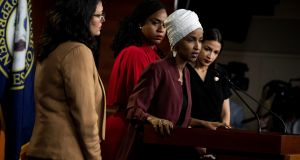 From left,  Ayanna Pressley, Alexandria Ocasio-Cortez and Rashida Tlaib listen as Ilhan Omar speaks on Capitol Hill in Washington. US president Donald Trump refers to the four Democrats as 'the squad'. Photograph: Anna Moneymaker/The New York Times)
