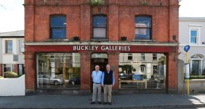 Brothers Sean and Michael Buckley outside their Sandycove auctioneering business which is due to close shortly after over 56 years in business. Photograph: Crispin Rodwell for the Irish Times