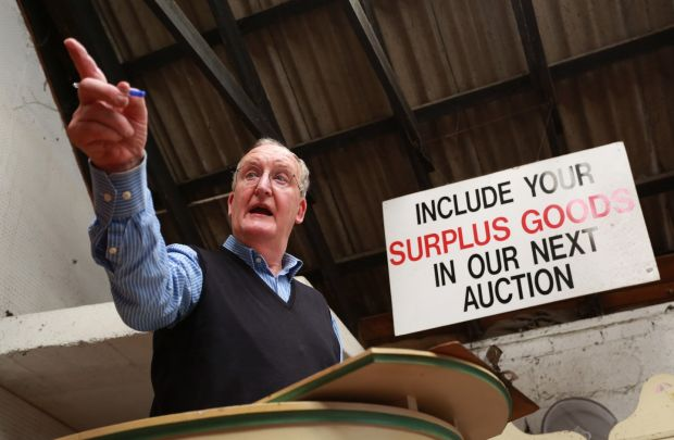 Michael Buckley on the podium in his Sandycove auctioneering business. Photograph by Crispin Rodwell