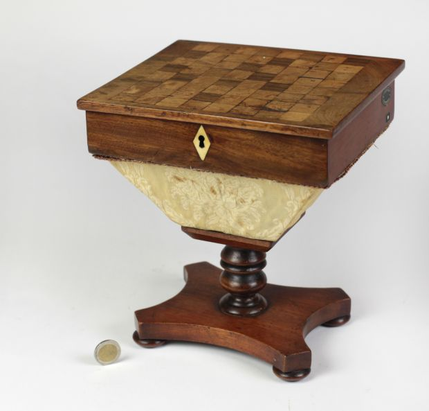 Lot 446: A William IV mahogany miniature apprentice made combinedgames' table and workbox, 9 inches tall, €350 - €450