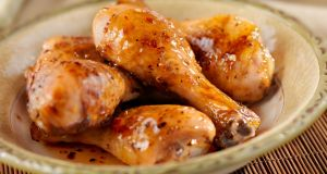 Glazed Chicken Drumsticks with a Sweet and Sour Sauce, Bread and Salad. Photograph: iStock