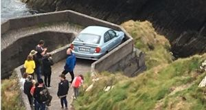 This hapless motorist was trapped on 'Sheep Highway' on Wednesday after venturing along the pedestrian walkway. Photograph: Blasket Island Ferries