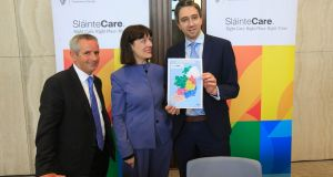 Minister for Health Simon Harris, right, with HSE chief executive  Paul Reid and Sláintecare executive director Laura Magahy, at  Wednesday's announcement. Photograph: Gareth Chaney/Collins