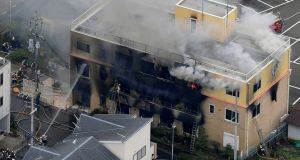 Smoke billows from a three-storey building in a fire in Kyoto,  Japan, on Thursday. Photograph: Kyodo News via AP