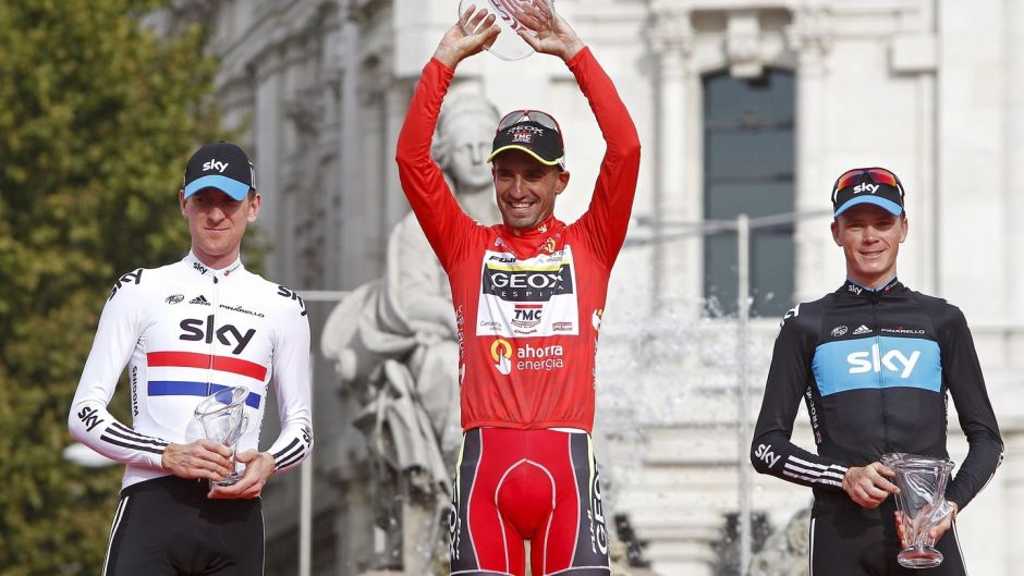Juan Jose Cobo celebrates his overall victory in the 2011 Vuelta next to Chris Froome (right), second, and Bradley Wiggins (left), third. Froome has officially been named winner of the Vuelta after Cobo was stripped of the title. Photograph: EPA