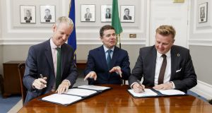 Andrew McDowell, European Investment Bank vice president with Minister for Finance and Public Expenditure and Reform Paschal Donohoe and Barry Napier, chief executive at Cubic Telecom. Photograph: Andres Poveda