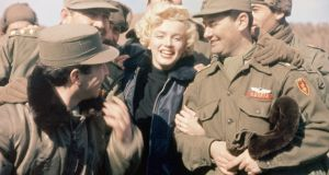 In 1954 Marilyn Monroe visited  American troops stationed  in Korea.