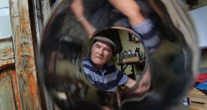 Last of the tin men, James Collins, working at his home in Avila Park, Dublin. Photograph: Alan Betson/The Irish Times