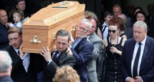 The remains of Karl Shiels are carried from church followed by his partner, Laura Honan.  Photograph: Colin Keegan/Collins
