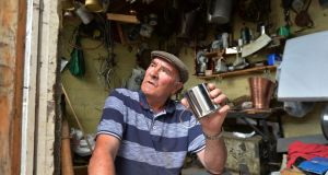 The last of the Tin Men, James Collins working away in his shed at his home in Avila Park Dublin. Photograph: Alan Betson