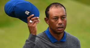 US golfer Tiger Woods reacts after finishing the 18th hole during the first round of the British Open. Photograph: Getty Images
