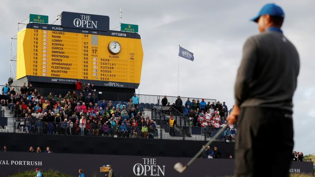 Golf - The 148th Open Championship - Royal Portrush Golf Club, Portrush, Northern Ireland - July 18, 2019 General view of the scoreboard as Tiger Woods of the U.S. looks on during the first round REUTERS/Paul Childs