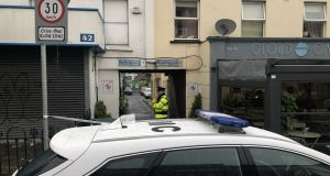 A garda at the scene of a fatal stabbing in north inner city Dublin. Photograph: Jack Power