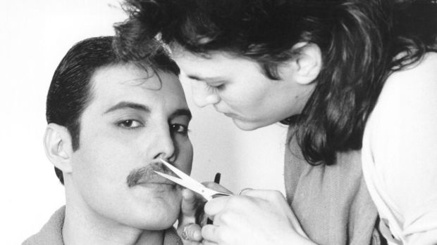 Freddie Mercury gets his moustache groomed in 1982. Photograph: Steve Wood/Express/Getty Images