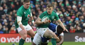 Ireland's Tadgh Furlong and Garry Ringrose with France's Demba Bamba  in their Six Nations clash  at the Aviva Stadium in March. The men's international game now accounts for 81 per cent of all IRFU revenues. Photograph: Lorraine O'Sullivan/PA Wire