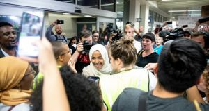 Supporters greet Ilhan Omar (centre) at St Paul Airport in Minneapolis on Thursday.  Photograph: Jenn Ackerman/The New York Times