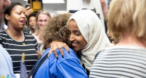 US Democratic Congresswoman Ilhan Omar, a target of the racially divisive rhetoric emanating from the White House this week, is greeted by supporters in Minneapolis on Thursday. Photograph: Jenn Ackerman/New York Times