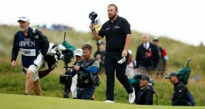 Shane Lowry comes up the 18th at Portrush with caddie Brian Martin. Photograph: Jason Cairnduff/Reuters