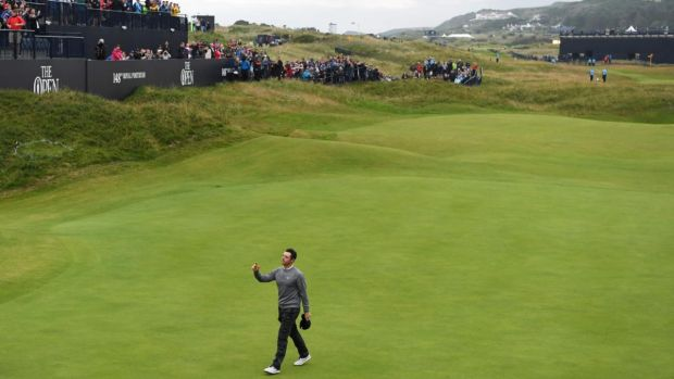 Rory McIlroy walks off after his second round of 65 at Portrush. Photograph: Paul Ellis/AFP/Getty