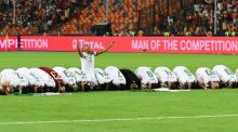 Algerian players pray after their Africa Cup of Nations final victory over Senegal. Photograph: Giuseppe Cacace/AFP/Getty