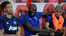 Manchester United's Romelu Lukaku  sits on the bench with teammates during the International Champions Cup football match between Manchester United and Inter Milan. Photograph: Getty Images