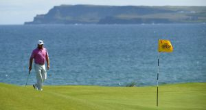 Graeme McDowell of Northern Ireland walks onto the fifth green during the third round of the 148th British Open at Royal Portrush. Photo: Stuart Franklin/Getty Images