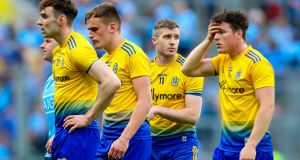 The Roscommon players after the game. Photograph: Tommy Dickson/Inpho