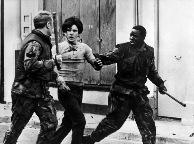 A teenager is arrested by British troops during a civil rights demonstration in Belfast. Photograph: Keystone/Getty