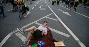 On the first Sunday when College Green has been closed to traffic and converted into a plaza, Luke Brabazon from Phibsboro Dublin chills out on Dame Street.  Photograph: Nick Bradshaw/The Irish Times