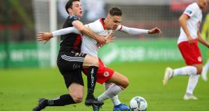 Bohemians' Kevin Devaney tackles Cian Coleman of St Pat's during his side's 3-0 win at Dalymount Park. Photograph: Tommy Dickson/Inpho